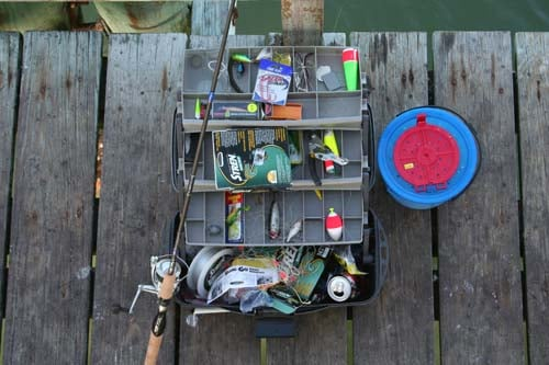 Clean tackle box with fishing rod and reel