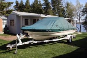 Covered fishing boat in a yard