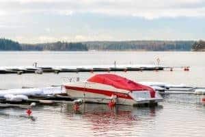 Covered fishing boat at the marina