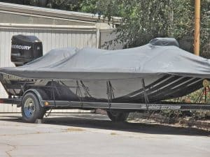 Bass boat covered in the driveway