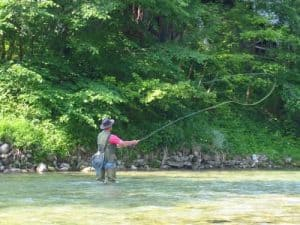 Person in river fly fishing