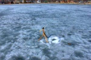 Ice fishing hole with fishing rod
