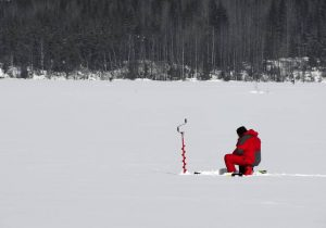 Man in red ice fishing