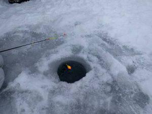 Ice fishing hole with bobber