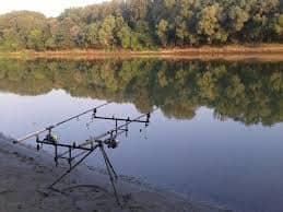 Multiple fishing rod holder by lake