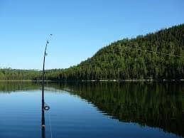 Fishing rod with lake and mountain