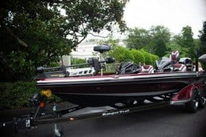 Bass boat sitting in a parking lot